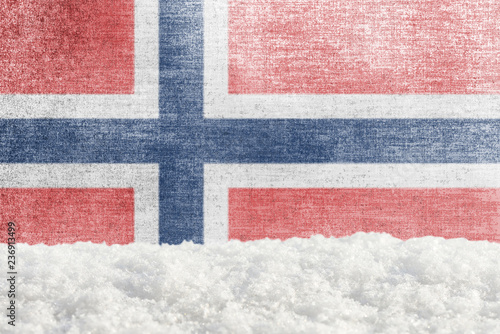 Photo  Winter grunge background with snowdrift and Norwegian flag in the backdrop