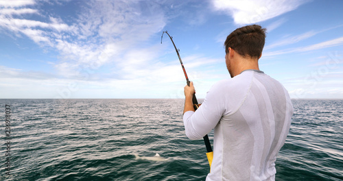 Printed kitchen splashbacks Fishing Shark fishing activity on fisherman boat in Florida. Travel tourist man catch and release of spinner shark.