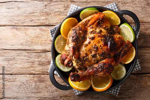 Cuban Chicken is infused with a flavorful Mojo marinade made with citrus, garlic and spices close-up in a pan. horizontal top view