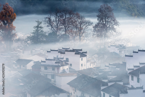 traditional chinese village at early morning in autumn