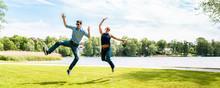 Young Stylish Couple Jumping I...