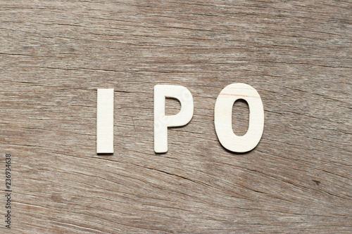 Fotografia, Obraz  Alphabet letter in word  IPO (Abbreviation of Initial Public Offering) on wood b
