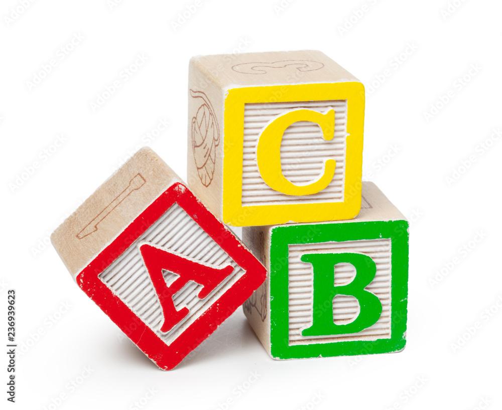 Fototapeta Wooden alphabet blocks isolated on white background