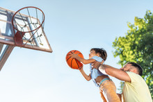 Father And Son Playing Basketb...