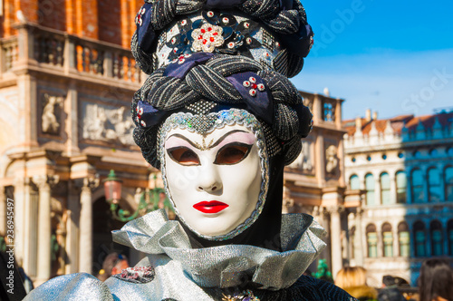 Person wearing venitian carnival mask during Venice carnival in Italy