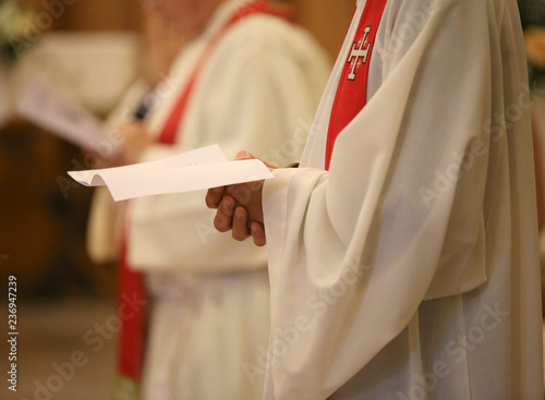Fototapeta priest with a cassock and hands joined in prayer