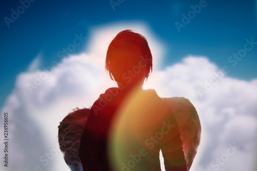 Photo Silhouette of a white and dark side of angel as symbol of the ambivalence of hum