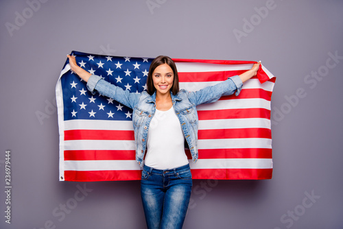 Cute sweet lovely confident smiling student lady emigrant holding USA american f Wallpaper Mural