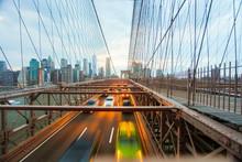 Buildings And Transportation On Brooklyn Bridge In Night New York.