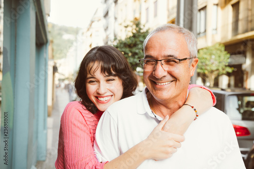 Portrait of happy father and daughter embracing on the street Wallpaper Mural