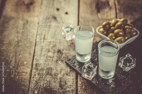 Traditional greek vodka - ouzo in shot glasses