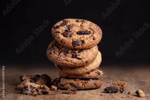 Spoed Foto op Canvas Dessert Chocolate cookies on old wood table. Chocolate chip cookies on dark background. Copy space