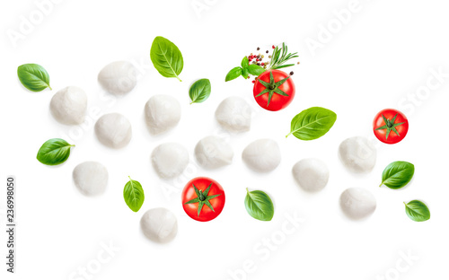 Mozarella, Basil leaf and  Tomatoes  isolated on white Background. Creative layout made of Food Ingredients for caprese salad.  Top view. Flat lay