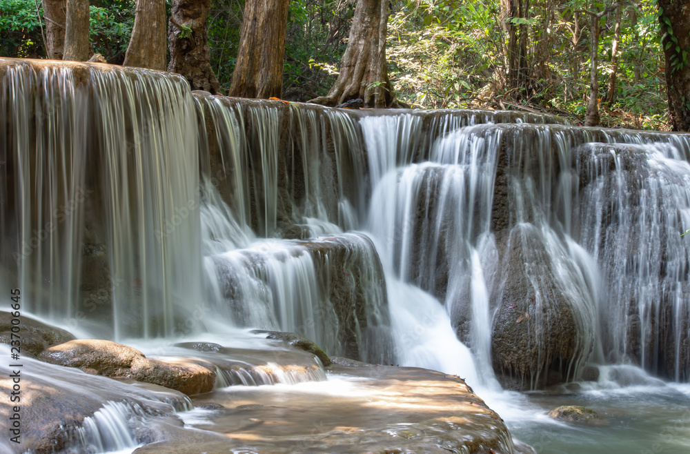 Fototapeta Waterfall flowing from the mountains at Huay Mae khamin waterfall National Park ,Kanchana buri in Thailand.
