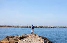 Man Fishing Off The Pier At Corona Del Mar, Newport Beach, California