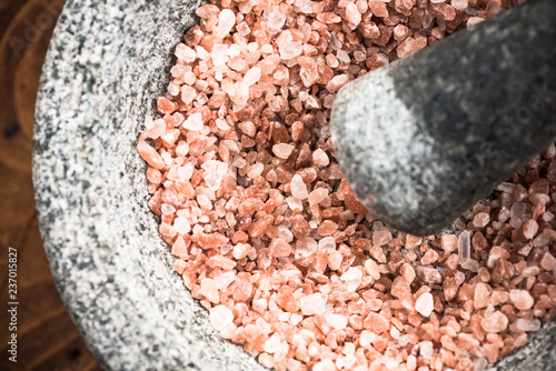 Himalayan pink salt seed in granite mortar or pestle Wallpaper Mural
