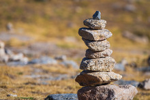 Zen Balanced Stones Stack In High Mountains. Scenic Mountain View.