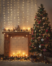 Beautiful Christmas Setting, Fireplace With Wooden Mantelpiece Fire Surround, Lit Up Decorated Christmas Tree With Baubles And Ornaments, Stars, Christmas Lights, Toned, Candles, Selective Focus