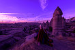 canvas print picture - magical dawn in Goreme Cappadocia Turkey. a girl in a canyon in traditional clothes surrounded by balloons in the rays of the rising sun