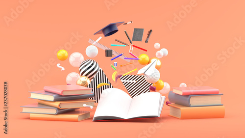 Obraz School Supplies Floating out of a book amidst colorful balls on a pink background.-3d render.. - fototapety do salonu
