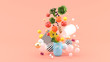 The food floats out of the capsule amidst colorful balls on the pink background.-3d render..