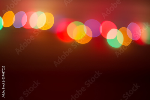 Foto  colorful bokeh lights on a red-brown background