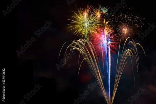 Staande foto Hoogte schaal Fireworks display over dark sky