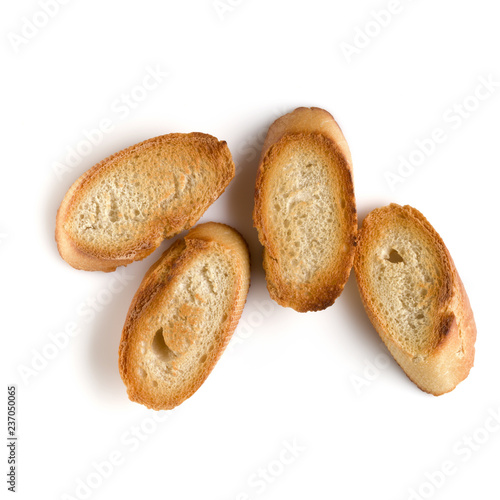 Toasted baguette slices isolated on white background close up. Toast, crouton. Top view.