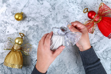 Diy Angel Plastic Bottle. Guide On The Photo How To Make A Decorative Angel From A Bottle, Self-adhesive Shiny Paper, Ribbon And A Christmas Ball With Your Own Hands. Handmade. Top View. Step By Step