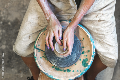 Master class concept. High angle above top flat lay view photo of professional occupation lady in her workwear she sit inside workspace behind circular wheel made clay tableware production