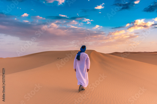 Berber man wearing traditional tuareg clothes in the Sahara Desert at dawn, Merz Canvas Print