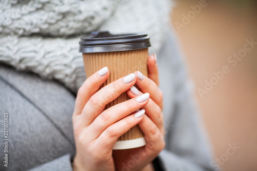 Fotografie, Obraz  Coffee to go. Young woman with coffee in the autumn park