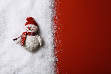 Composition With Small Decorative Snowman On Color Background, Top View