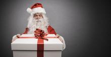 Santa Claus Bringing A Gift With Red Ribbon