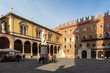 Statue of Dante Alighieri in Piazza dei Signori, Verona, Italy-23 ottobre 2018. Beautiful statues of Dante in the middle of Verona old town with other sculptures and architecture. Summer day in Verona