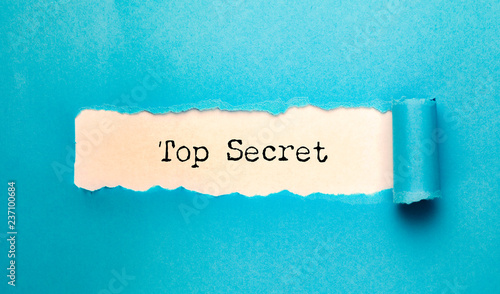 Photo top secret with torn paper