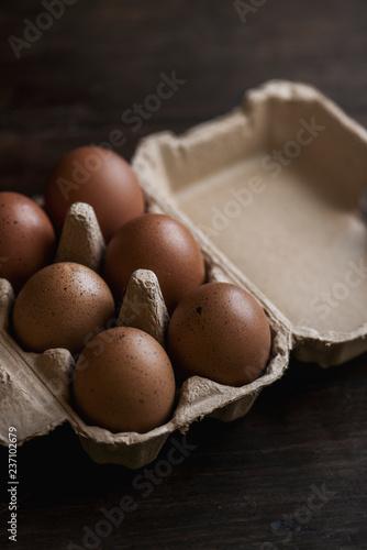 Closeup of fresh organic eggs in a paper box