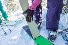 Man Freerider Installs Glue Camus On Skis, In Snow Wild Mountains