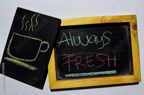 Fotografie, Obraz  Drawing cup of coffee and Always FRESH on phrase colorful handwritten on blackboard white background