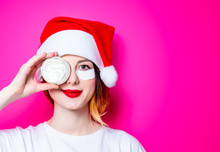 Woman Using Eye Patch For Her Eyes In Santa Claus Hat With Cream On Pink Background Isolated. Portrait Of Natural  And True Female As Usually They Are Looks Like