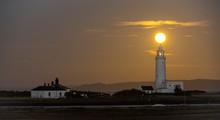 Hurst Point Lighthouse And Full Moon