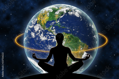 Obraz Female yoga figure against a space background and a planet Earth. Elements of this image furnished by NASA. - fototapety do salonu