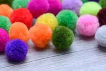 A Colorful  Pom Pom With White...
