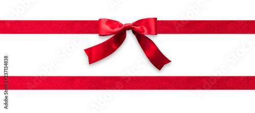 Leinwand Poster Red ribbon band stripe or satin fabric bow isolated on white background with cli