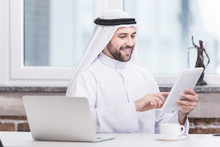 Arabian Businessman Using Digi...