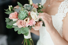Bride Holding A Bouquet Of Flowers In A Rustic Style, Wedding Bouquet. Soft Focus