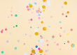 Colored confetti on yellow background