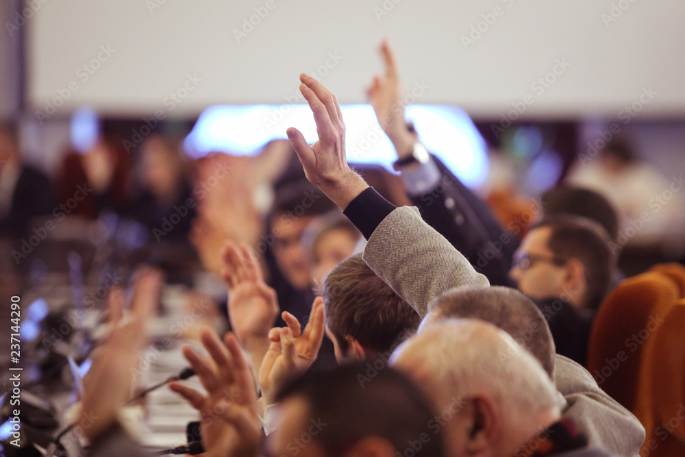 Fototapety, obrazy: Members of Parliament voting by raising hands