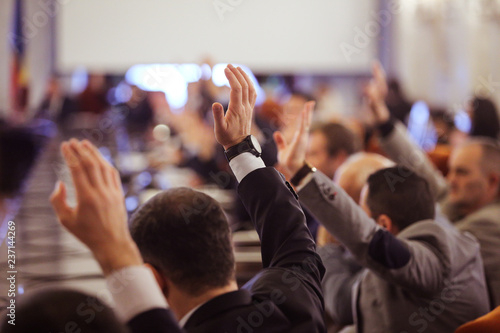 Fotografie, Obraz  Members of Parliament voting by raising hands