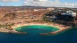 Beautiful aerial view of the full Playa de Amadores bay beach on Gran Canaria island in Spain.
